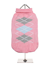 Baby Pink / Grey Argyle Sweater - Knitted Baby Pink / Grey Argyle Sweater with a pink and grey diamond pattern. The Argyle pattern has seen a resurgence in popularity in the last few years due to its adoption by Stuart Stockdale in collections produced by luxury clothing manufacturer, Pringle of Scotland. The rich Scottish heritage...